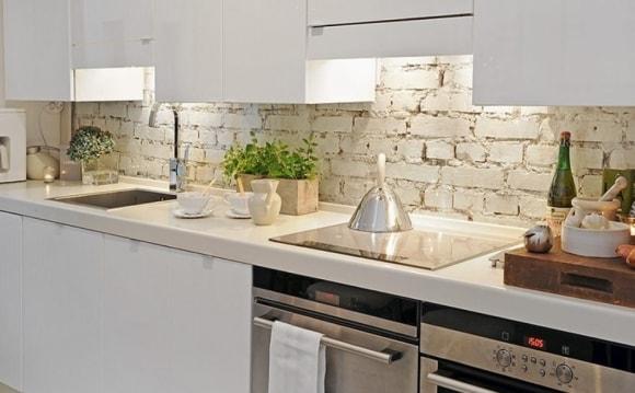 Отделка декоративным искусственным камнем кухни фото