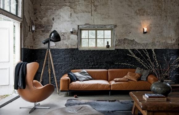 Кожаный диван в интерьере стиля лофт