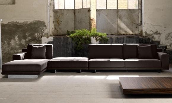 Угловой диван в интерьере стиля лофт
