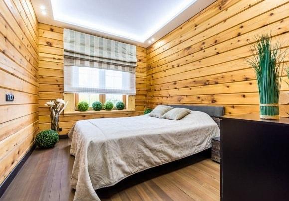 Дизайн интерьера спальни скандинавского стиля в доме из дерева