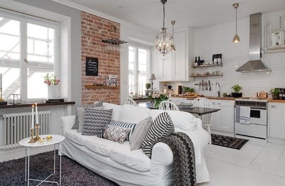 Гостиная в скандинавском стиле совмещенная с кухней в квартире