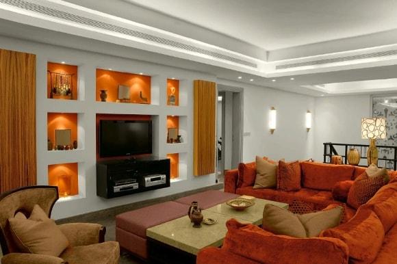 Современная стенка из гипсокартона в гостиной комнате
